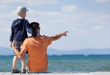 father and son looking out over Lake Tahoe